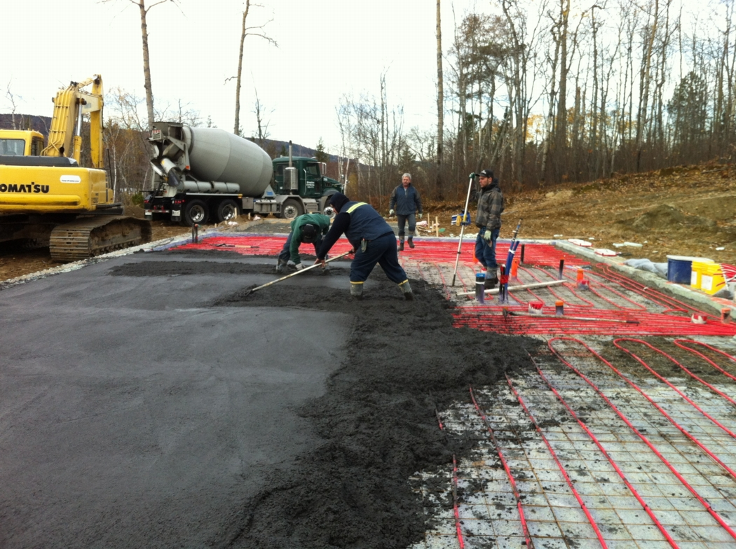 Pouring the slab with embedded tubing for radiant-floor heat. Photo: Alain Hamel