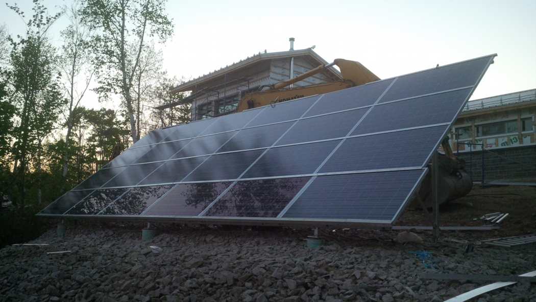 The 5.4 kW solar array is ground-mounted southeast of the house. Photo: Alain Hamel