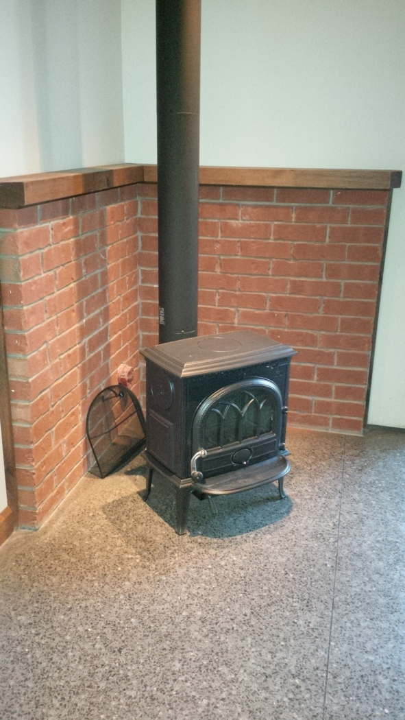 Back-up heat is provided with a wood stove. Photo: Alain Hamel
