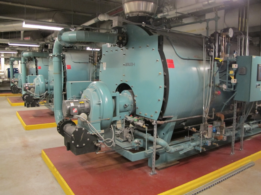 Three high-efficiency, 200-horsepower, gas-fired-boilers located in the penthouse mechanical room operate on a rotating schedule (to equalize run time). They use condensate water from mechanical equipment to preheat make-up water for additional savings. Photo: Alex Wilson