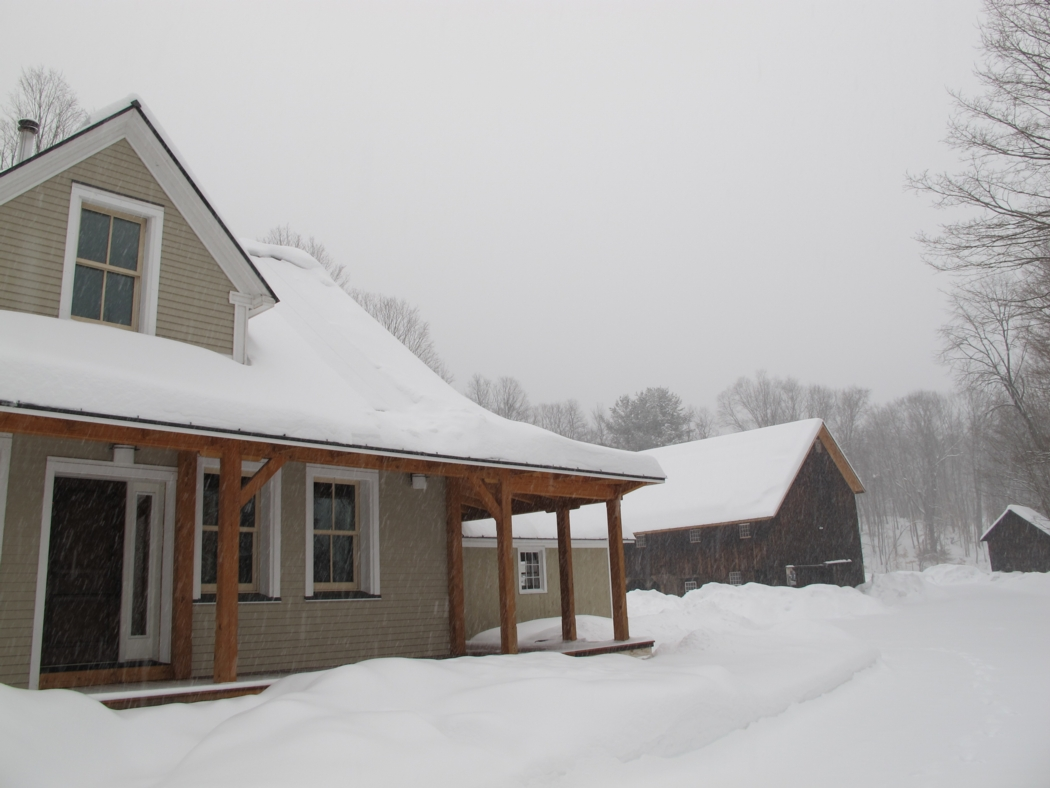 Our house and barn in a snowstorm last week. Photo: Alex Wilson