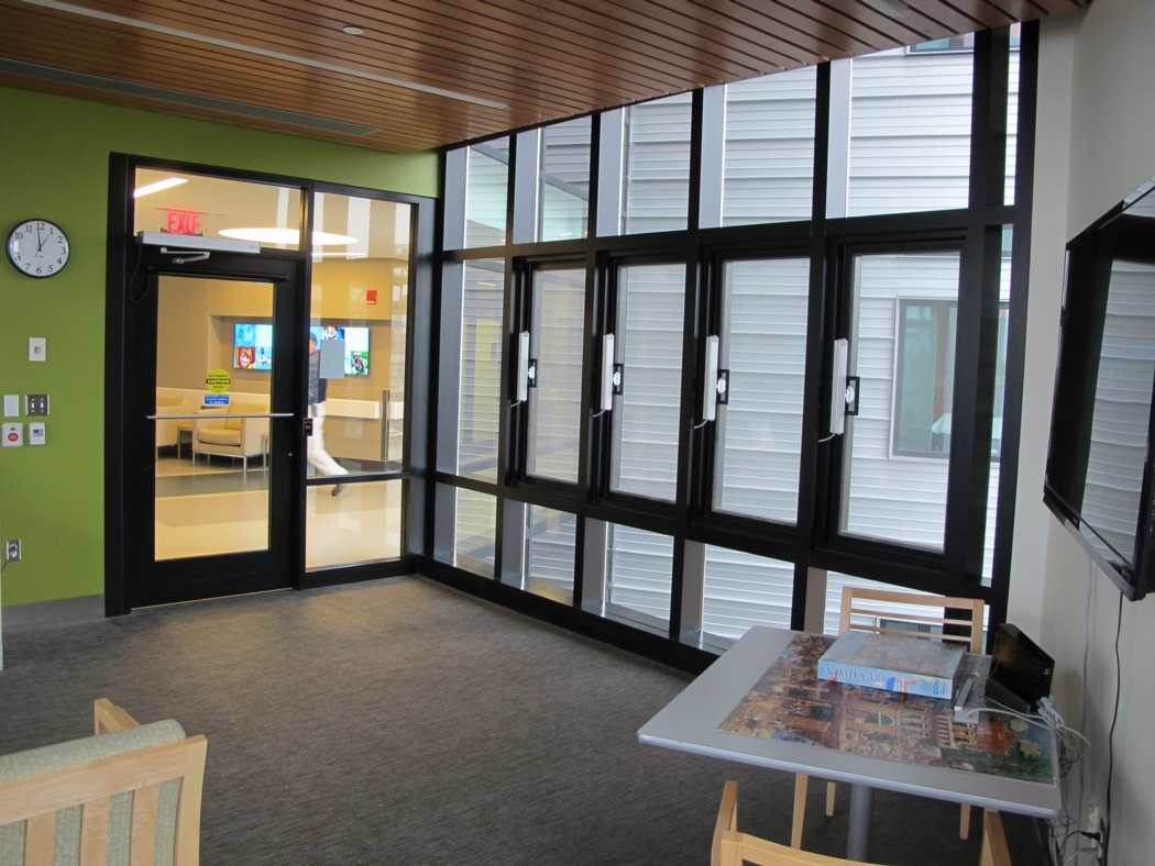 A bank of large operable windows in a hospital lounge. Photo: Alex Wilson