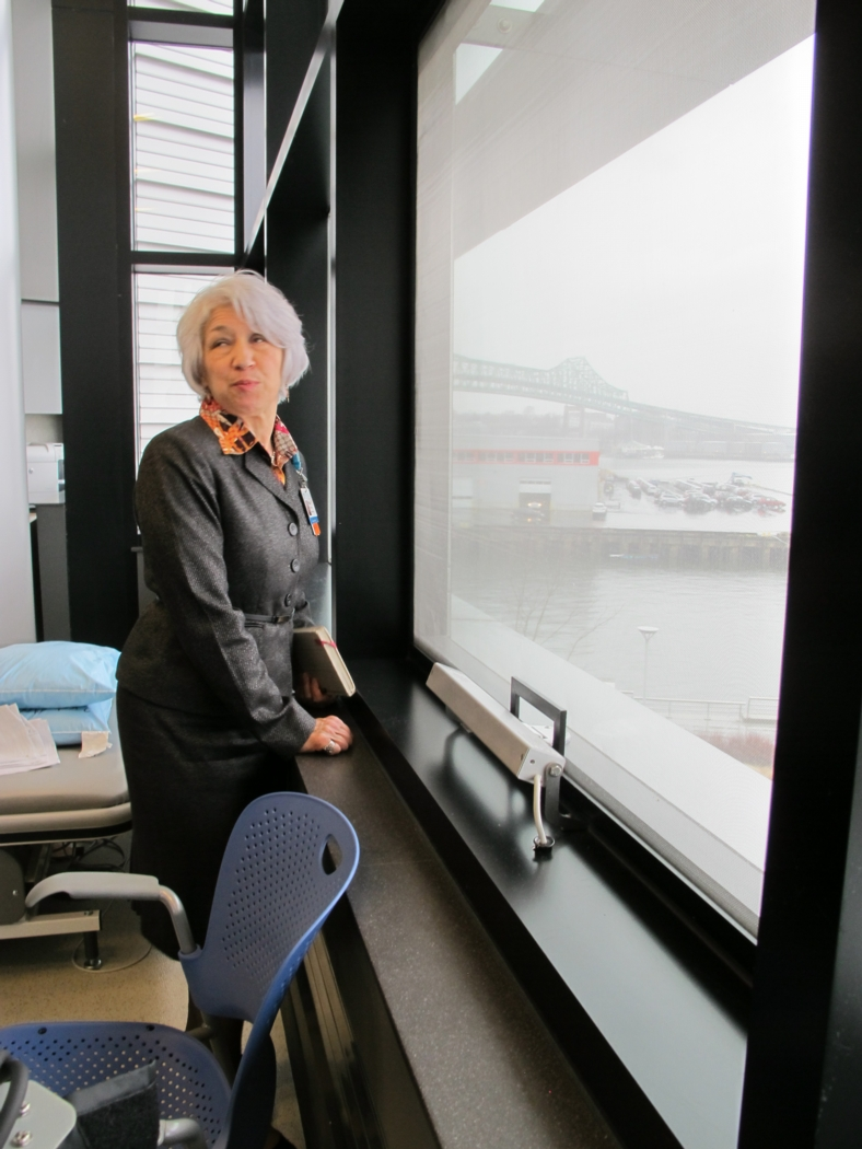 Paula Hereau, Vice President for Hospital Operations at Spaulding, in front of one of the operable windows in a meeting space. Photo: Alex Wilson