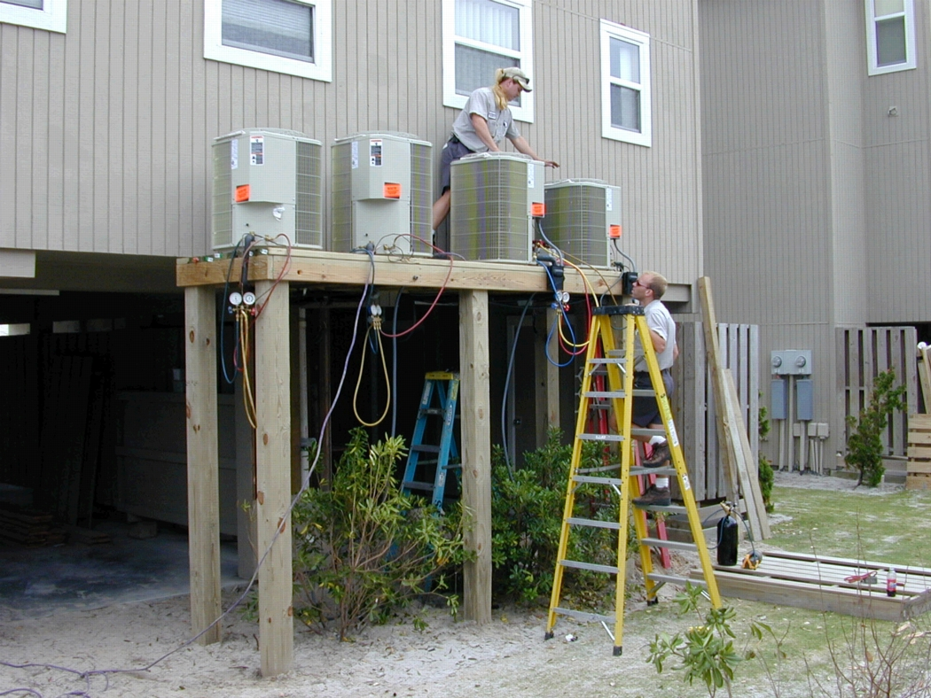Elevating mechanical equipment following hurricane damage in Carolina Beach, North Carolina. Photo: Dave Saville, FEMA