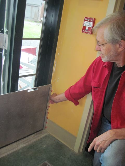 A simple flood barrier on an entry door at the New England Youth Theater in Brattleboro, Vermont. During Tropical Storm Irene, floodwater came to within an inch-and-a-half of the top of these flood barriers. They prevented hundreds of thousands of dollars in damage. Photo: Jerry Stockman