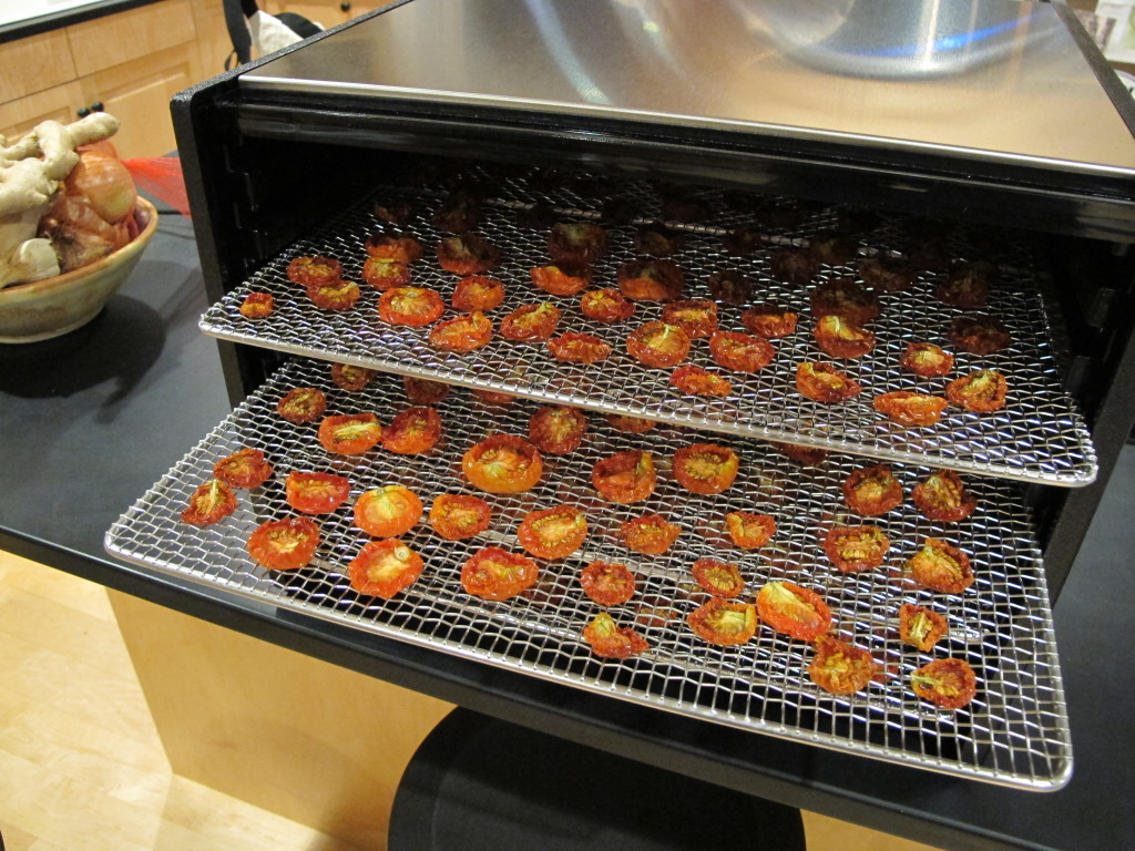 Drying tomatoes at home. Can I call them sun-dried if the electricity used by our dehydrator is generated from PV panels? Photo: Alex Wilson